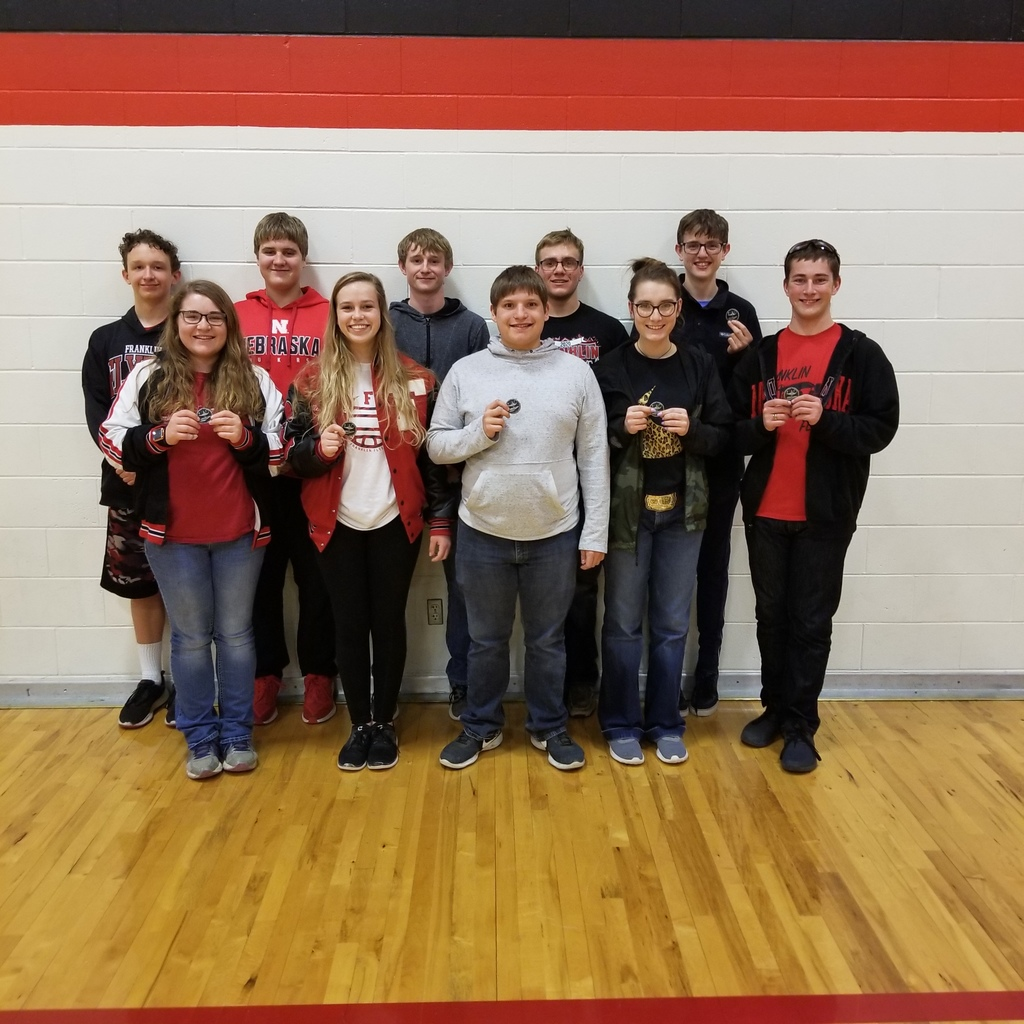High School Quiz Bowl Team holding their 2nd place medal from the Alma Quiz Bowl Meet.